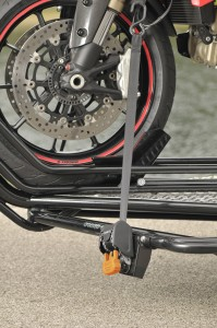CargoBuckle 1 inch mini transom ratcheting tie-down securing motorcycle to a trailer.